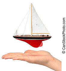 Hand with yacht model