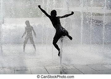 happy wet summer kids playing in water fountain