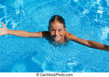 child on summer vacation in swimming pool