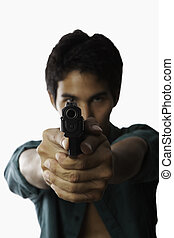 young asian man with automatic pistol