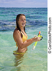 girl in the ocean with mask and snorkel - teenage girl in...