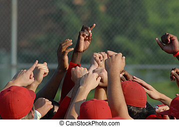 Hands in the air after a big win at a baseball game