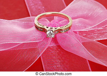 diamond ring on pink bow - closeup diamond ring on pink bow