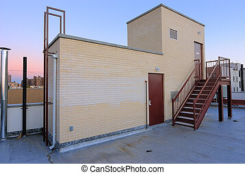 Rooftop Entrance - A stairwell exit for rooftop access