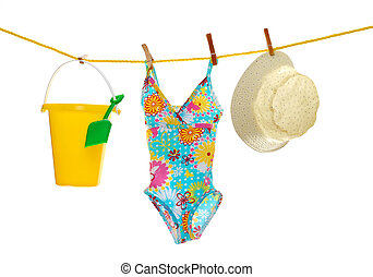 beach wear and toys clothes line - isolated baby girls beach...