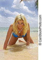 beautiful young woman in an Oahu lagoon