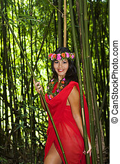 polynesian woman in a bamboo forest - beautiful young...