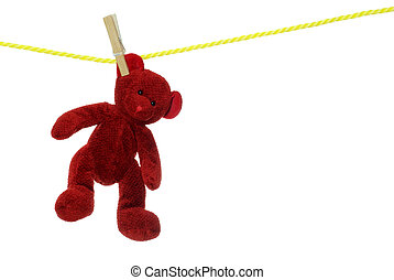 Red teddy bear on clothes line