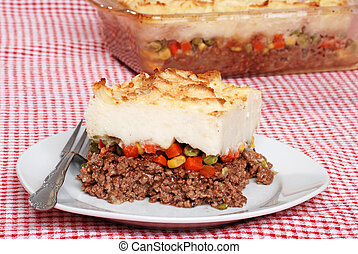 shepards pie with a fork - closeup shepards pie with a fork