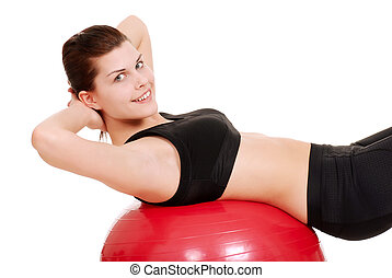 young woman using exercise ball