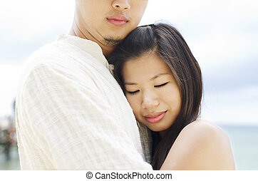 Sweet moment - Loving Asian Couple at outdoor beach