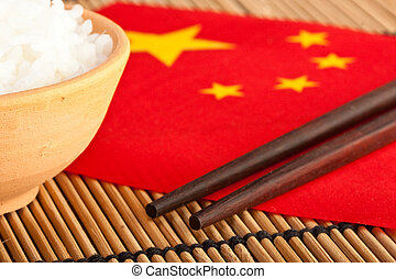 Chinese food (2) - Rice bowl and chopsticks on chinese flag...