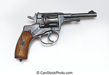 Old revolver on white background