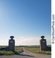 Gate open on a road with blue sky