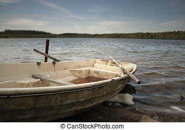 Rowing boat - Old rowing boat left on the bank of a large...