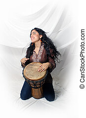 Beautiful Latina playing a Djembe Drum 2 - A lovely young...