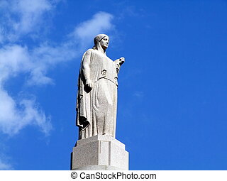 Monument in Providence against the blue sky