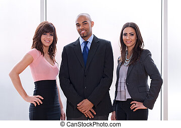 Business team of three - Happy and proud business team,...