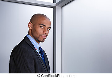 Young businessman beside a window