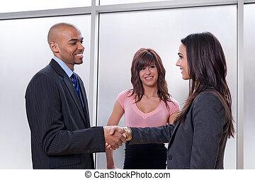 Business man and woman shaking hands - Business team of...