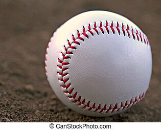 Baseball Sitting in Infield Dirt - Closeup of a Baseball...