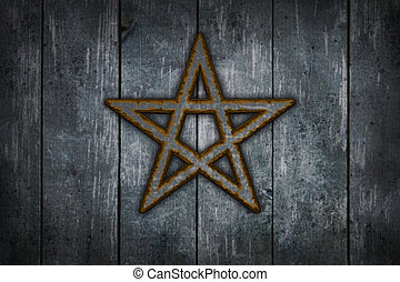 pentacle - rusty pentacle on wooden grunge background - 3d...