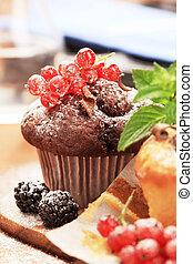 Muffins - Tasty muffins garnished with berry fruit - detail