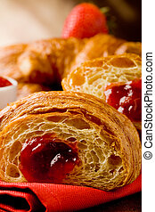 Croissants with marmelade - delicious golden croissants...