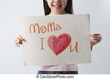 mama, I love you - studio shot of little girl with a message...