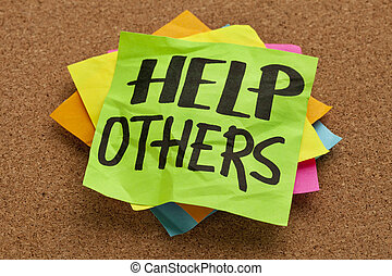 help others reminder on sticky note posted on a cork board