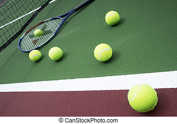 Tennis ball and racquet on Court - Bright greenish, yellow...