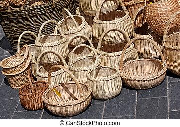 Wicker baskets on sale - A bunch of traditional wicker...
