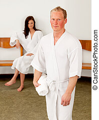 Serious Man in Bathrobe - A serious looking caucasian man in...