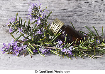 Rosemary - Some rosemary with flowers and a jar with...