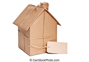 House wrapped in brown paper cut out - Photo of a wrapped...