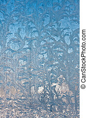 Ice flowers on window glass, wintertime