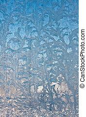 Ice flowers on window glass, wintertime