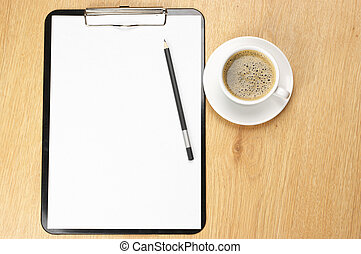 Clipboard and coffee - Clipboard with blank page and cup of...