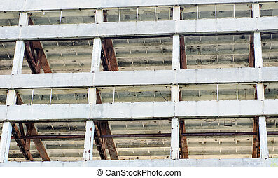 The frame of a building under demolition.Abstract background