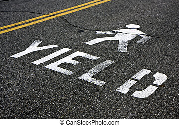 Pedestrian yield sign on a road - Warning at crossroad...