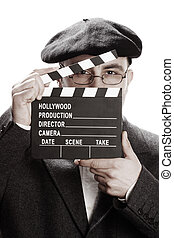 Old fashioned man and movie clapper - Old fashioned man...