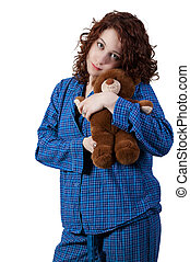 Woman Hugging Teddy Bear - A beautiful young woman wearing...