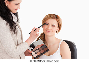 Attractive woman having her make up