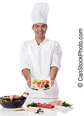 Young nepalese man chef, oriental food - Young cheerful...