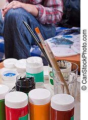 Body painting equipment - Jars of colorful paint, brushes,...