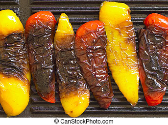 grilled bell peppers - close up of grilled bell peppers on a...