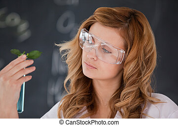 Attractive female scientist looking