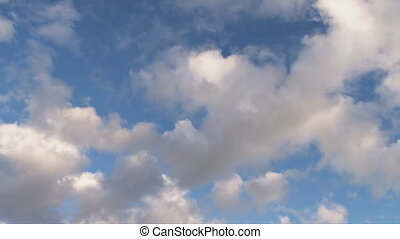 Clouds diagonal - Puffy cumulus move diagonally, clearing as...