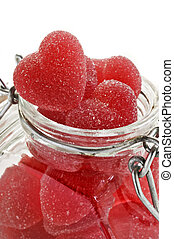 Red heart shaped jelly sweet in a glass jar