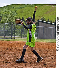 Girl Softball Pitcher - A young girl ready to throw a pitch...